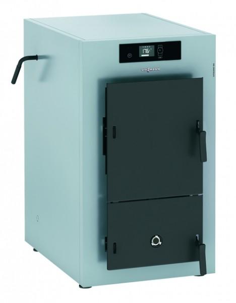 Photo 1 La Vitoligno 150-S est une chaudière compacte à gazéification pour bûches de bois, d'un prix particulièrement attrayant, adaptable à un fonctionnement monovalent ou à un fonctionnement bivalent (complément à une installation de chauffage au fioul ou au gaz).  La régulation Ecotronic 100 séduit par sa commande facile et intuitive. Sur son écran rétro-éclairé, toutes les informations sont représentées par symboles. L'écran affiche aussi l'état de chargement du réservoir tampon d'eau chaude. - Viessmann France