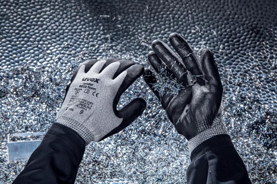 Photo 2 Grâce à la combinaison fibres HPPE et fibres de verre, uvex unidur 6659 foam garantit une protection élevée contre les coupures. Son enduction en mousse NBR est très résistante à l'abrasion et son coloris gris chiné peu salissant, ce qui en fait une solution particulièrement durable ! Les gants de protection uvex unidur 6659 sont souples et offrent un bon grip dans les environnements secs et légèrement humides. - uvex