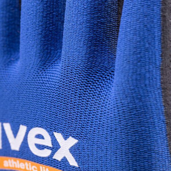 Photo 4 Grâce au design « SlimFit » et à l'élasthanne contenu dans le liner, les gants uvex athletic lite offrent un ajustement ergonomique, une sensibilité tactile et une dextérité exceptionnelle pour les travaux de précision. Ainsi, ils assurent un confort de port optimal, réduisant les risques d'apparition de signes de fatigue, même après une journée de port. Ils sont particulièrement adaptés aux travaux de contrôle, de tri, de maintenance, d'assemblage, de menuiserie et pour la pose de placo. - uvex